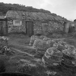 Fishermen's huts and lobster pots, Prussia Cove, St Hilary, Cornwall. 1970