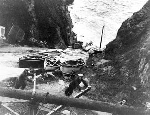 Hauling boats up the slipway using the old capstan, Porthgwarra, Cornwall. Early 1900s