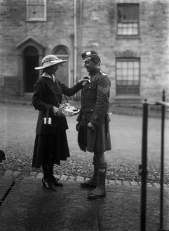 Lady and soldier on Flag Day, Boscawen Street, Truro, Cornwall. 18th October 1916
