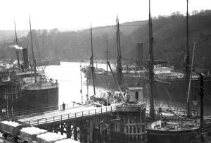 Loading clay into a schooner at Fowey Harbour, Cornwall. Early 1900s