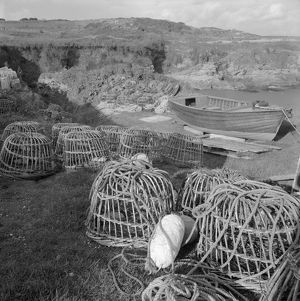 Lobster pots and boat, Prussia Cove, St Hilary, Cornwall. 1970