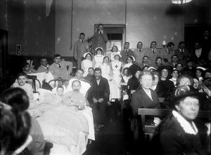 Nurses and patients watching a show in a hospital, Cornwall. 25th January 1916