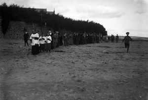 Procession across the beach at Gunwalloe Church Cove, Cornwall. Early 1900s