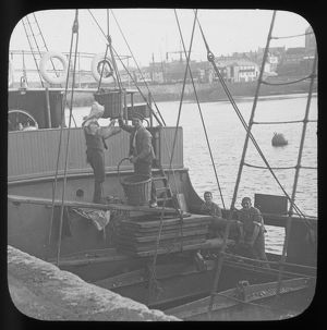 Steamer coaling, Penzance Harbour, Cornwall. Early 1900s