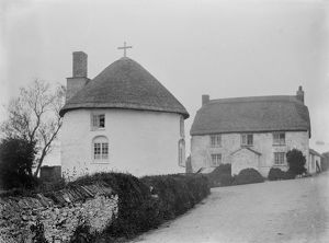 Thatched round house with a cross, Veryan Green, Veryan, Cornwall. 1910
