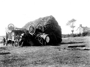 Threshing machine in collision with a hayrick. Possibly in St Stephen in Brannel, Cornwall