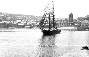 Unidentified topsail schooner underway leaving St Ives harbour, Cornwall. Early 1900s