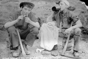 Two young miners at croust time at an unidentified mine in Cornwall. Late 1800s